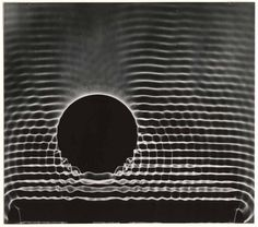 Berenice Abbott, Behavior of waves    Good example of simple composition, with little background distractions
