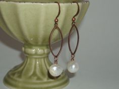 Pearl with copper earrings. $24.00, via Etsy.