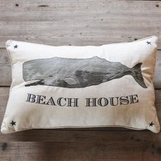 Reminiscent of a pencil sketch, our Whale Beach House Pillow adds a casual style to your living space. Linen cover provides texture. Embroidered details.