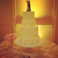 Showered With Love Wedding Cake.  2-Tier, Piping, Butter Cream Flowers, Umbrella Couple Topper.
