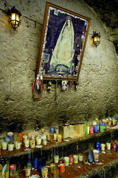 Candles and votive offerings at the church of Our Lady of Izamal, Yucatán.