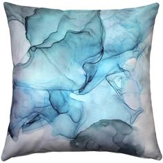 A soft, smoky pattern in blue and turquoise tones makes the Khyber Haze Blue Throw Pillow a visual delight.