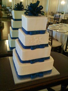 Navy blue bows & simple dotted Swiss square wedding cake. Made by Ye Olde Pie Shoppe, free consults732-530-3337