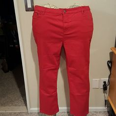 Liz Claiborne red 5 pocket Jackie crop jeans Cotton polyester spandex blend 5 pocket jeans with brass rivet accents. Inseam 27.5 inches. Brand new without tags and never worn. Liz Claiborne Pants Ankle & Cropped