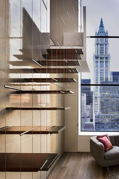 TriBeCa Penthouse - New York _ One of our favourites in this apartment are the stairs. They are made of ¾-inch-thick steel plates wrapped in leather. The stairs appear to float in space and take up almost no visual room yet they are also stunning eye-catchers. Stairway to heaven, indeed, or at least toward it. - Tuija Seipell.