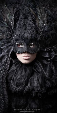 Black, mask, feathers.  Artwork by Miss Overdose