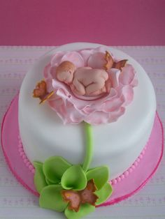 "Flower baby - A 6"" marble cake with dulce de leche filling for my neighbour who just had a baby.  I didn't have enough time to properly finish the leaves.  Baby was done using the baby mold.   TFL"