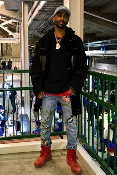 Big Sean wearing Alexander Wang Shearling Collared Jacket, Timberland 6 Inch Premium Boot, Gucci Embroidered Denim Pants