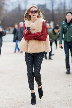 Olivia Palermo looked chic in a cream fuzzy vest over a cherry red silk blouse and printed pants during Paris Fashion Week. Olivia Palermo looked chic in a cream fuzzy vest over a cherry red silk blouse and printed pants during Paris Fashion Week.