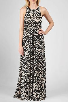 This elegant maxi dress features a simplistic neckline, empire waist, and racerback detail. Captured in this beautiful print that will make you feel like you're on an island getaway.