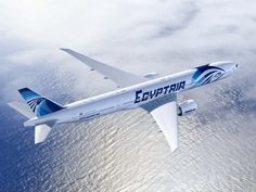 A stunning photo of an EGYPTAIR Boeing 7773ER flying over the ocean to Nigeria, Lagos