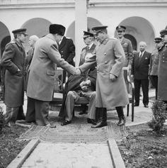 RT's WWII Tweets @Voina_41_45eng   February 1945. Stalin shaking Churchill's hand, with Roosevelt in the background