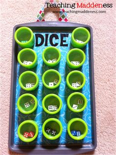 I need to go to Target more! Quiet, magnetic dice shakers - LOVE IT! *Teaching Maddeness*