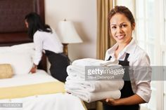 Stock Photo : Young maids cleaning and preparing room for hotel guests