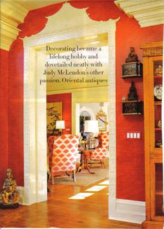 Chinoiserie door frame and coral walls