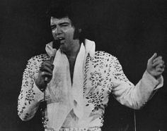 "Rocking and rolling at the Nassau Coliseum on June 23, 1973. Elvis sings ""Flip, Flop & Fly"".  Photo: Phil Gelormine/Elvis World (c) 1973"