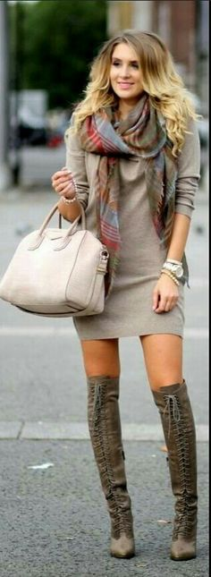 I love everything about her oufit and the color combination.  Her boots! I wants some!
