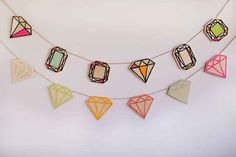 Make a gemstone garland to add interest to a boring white wall.