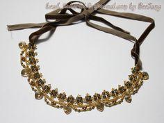 MATERIALE: biconi 4 mm (Crystal Bronze Shade) perle 3 mm (Powder Almond) cuori 10 m...