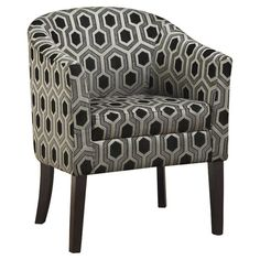 Barrel-back club chair with patterned upholstery.  Product: ChairConstruction Material: Fabric and woodCo...