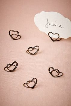 Simply shaped in brass wire, dainty hearts welcome each guest to their place setting