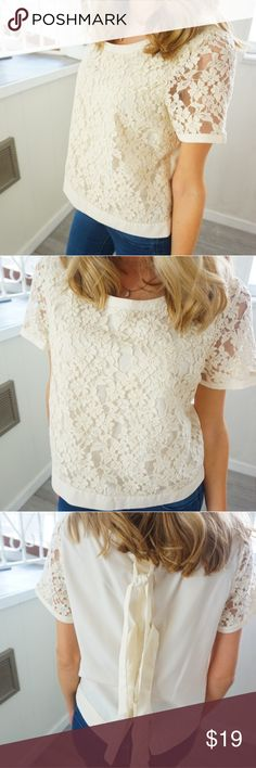 Lauren Conrad lace blouse short sleeve with ties❤ Lauren Conrad lace blouse short sleeve shirt with three the backs and button up in the back cream color. Tops Blouses