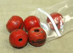 Rare Sherpa Coral beads from Nepal/Tibet. Made to replicate red coral beads, but made of glass. Old and worn beads from the late 1800s. Typically