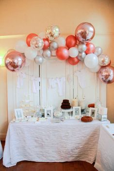Loving the colors of the balloon garland at this Women Empowerment Baby Shower!! See more party ideas and share yours at CatchMyParty.com #babyshower #womenempowerment #babyshowerdesserttable #balloongarland