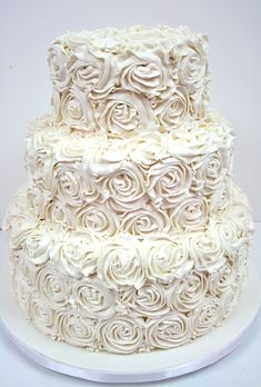 A Wedding Cake With Buttercream Rosettes by Sweet Grace.