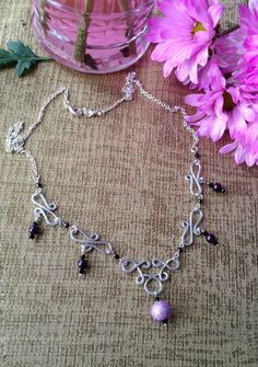 This lilac contemporary necklace is homemade with silver plated wire that is hammered to a radiant shine! Elegant and inspirational with a