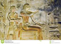 Un dibujo en relieve representando el dios sentado con los colores muy bien conservado, tour y visita a Abydos, visita del templo de Seti I  #escursion_a-Abydos #tour_a-Abydos #visita_del_templo #excursiones_en-Egipto  http://www.maestroegypttours.com/sp/Excursi%C3%B3nes-en-Egipto/Luxor-Excursiones/Tour-a-los-templos-de-Abydos-y-Dendera-desde-Luxor