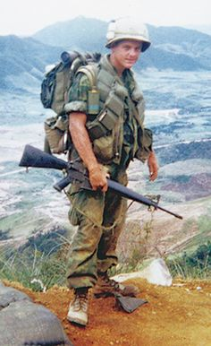 L/Cpl. Ben Reed of Eunice, La., stands atop Signal Hill overlooking Vandegrift Combat Base. Ben and members of Kilo 3/9 were preparing to leave the communications post for Operation Utah Mesa to the south. Spring of 1969.....