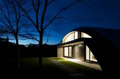 Wonderful Curved Exterior House Design Ideas At Dark Night View Feat Modern Outdoor Lighting