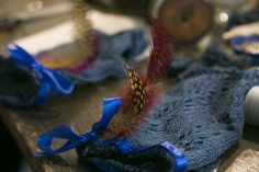 Embellish your wrist warmers with feathers & ribbon