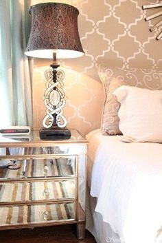 I love the stencil in a shimmery metallic on the wall behind the bed (and little else) in this room.