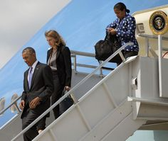 President Barack Obama, left, walks down the stairs of Air Force One accompanied by Sec. of Health and Human Services, Sylvia Mathews Burwell, center, and National Security Advisor Susan Rice, right, during their arrival at Hartsfield-Jackson Atlanta International Airport, Tuesday, Sept. 16, 2014, in Atlanta. Obama is traveling to Centers for Disease and Control and Prevention (CDC), to address the Ebola crisis and announce a plan to help the West Africa nations fight the spread of the Ebola…