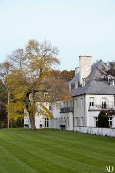 The Krakoffs painted the house's original redbrick exterior white. | archdigest.com