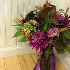 November bouquet with hydrangea, mums, dogwood, wheat and more.