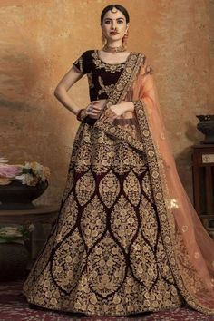 Dark Maroon velvet semi stitch lehenga with velvet choli. This U neck and Short Sleeves clothing designed with Sequins, Zari, Dori and Stone Work. Product are available in 32 to 58 sizes. It is perfect for Bridal Wear. Lehenga Choli Online, Bridal Lehenga Choli, Indian Lehenga, Silk Lehenga, Saree Wedding, Rohit Bal, Lehenga Indien, Art Marron, Maroon Color