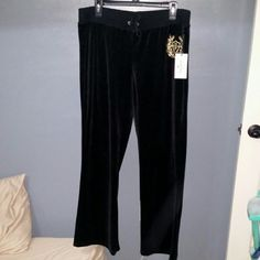 NWT JUICY COUTURE BLACK VELOUR SWEAT PANTS L New with tags. Juicy Couture Black velour sweat /track pants. Flare. Two button back pockets. Gold emblem on front hip.  Sorry, pics aren't the best. Juicy Couture Pants Track Pants & Joggers