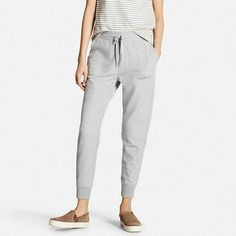 These women's jogger pants are made from sturdy material, yet feature a soft texture for a relaxed feel. The elastic drawstring waist provides a gently snug fit, and the tapered cut is comfortable yet sleek and stylish, perfect for trendy looks.