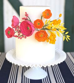 White wedding cake with pink, orange + yellow sugar flowers ... Wedding ideas for brides & bridesmaids, grooms & groomsmen, parents & planners ... https://itunes.apple.com/us/app/the-gold-wedding-planner/id498112599?ls=1=8 … plus how to organise an entire wedding, without overspending ♥ The Gold Wedding Planner iPhone App ♥