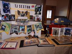 You can see most of TJ's display here. HE has a big arrow of light award, which I displayed on a music stand in back of table so kids would not ruin the arrow with feathers on it.