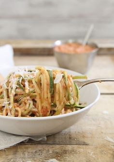 Zucchini noodles with creamy roasted tomato sauce is a delicious vegetarian pasta-like meal perfect for using up summer produce.