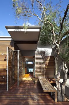 Timber screened entry to China Beach house, Discovery Coast, Queensland by Bark Design Architects photo by cfjphoto.com.au