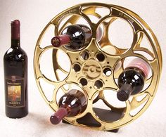 Vintage 35MM Film Reel remade into wine rack - very cool!