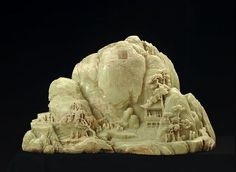 """Artist Unknown, Jade Mountain, Illustrating the Gathering of Poets at the Lan T'ing Pavilion, 1784 Light green jade 22 1/2 x 38 3/8 in. This miniature is an example of small scale art.  """"This mountain, apparently the largest piece of historic carved jade outside of China, was commissioned in 1784 by the Ch'ien-lung emperor (1736-95) whose own poem appears carved on the backside."""