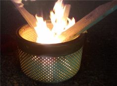 Build your own fire pit using the metal basin from an old washing machine.
