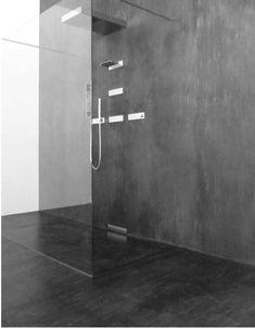 """Beton Ciré - französisch für """"gewachster Beton"""" - ist ein wasserfester Feinputz in Sichtbetonoptik. Die Spachtelung der Oberflächen erfolgt in individueller Handarbeit. Daher sind Oberflächenstrukturen von matt bis seidenglänzend möglich. Durch die Beimischung von Farbpigmenten lassen sich wunderschöne Farbvarianten realisieren. Besonders für den Einsatz im Nassbereich für fugenlose Bäder geeignet."""