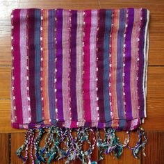 Reward yourself with this handcrafted purple rainbow scarf from Nepal. Makes a fine gift too.....http://c-fund.us/83f